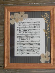 Framed sheet music hymns with real dried and pressed flowers.